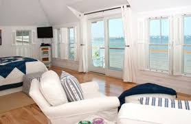 View in gallery View outdoors adds to the beach style inside the bedroom