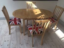 oval solid oak dining set extendable table and 4 upholstered chairs with union jack covers