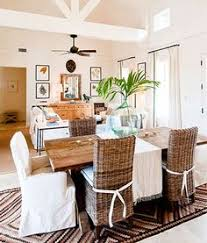 tropical island dining room with bobo intriguing objects 8 light wine barrel chandelier salvaged wood rectangular dining table seagr side dining chairs