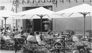culture of history people clothing traditions women  people at an outdoor cafe in cafes are social centers for men in southern