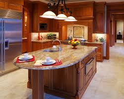 rounded granite kitchen island with decorative wood