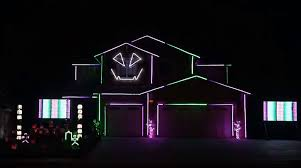 creative lighting display. here is a house decked out with lights that do some groovy stuff to the ghostbusters theme song by creative lighting displays which famous for their display m
