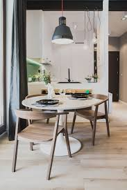small dining space for space savvy apartment with round table and pendant light in gray