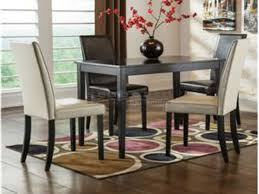 kimonte ivory and brown chairs 5 piece dining collection ashley d250 the straight line table