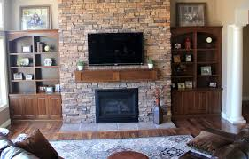 comfortable living room idea solid wood flooring rectangular fl pattern rug modern stone fireplace mantels built in side shelving unit with bottom