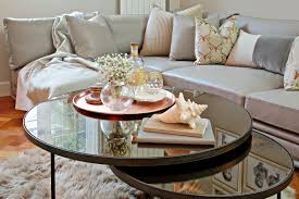 copper and rose gold styling within this contemporary interior space the coffee table is bronze