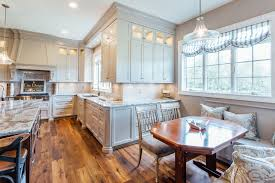 taupe custom kitchen with wood island pantry family owned western new york custom cabinetry