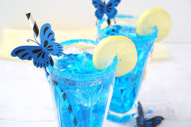 blue erfly cocktail inspired by alice through the looking glass