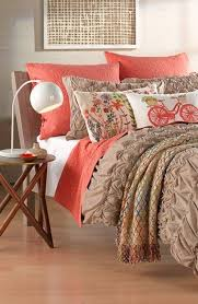 Pinterest & Love the coral accents on this bedding. Adamdwight.com