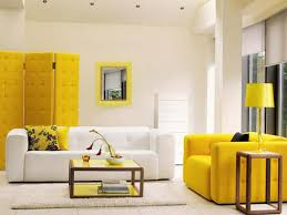 Yellow Living Room Decor Living Room White Bookcases Gray Sofa Black Console Table Brown