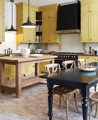 yellow kitchen cabinet painting ideas with black stove corbels or