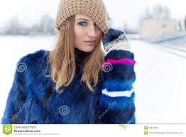 beautiful cute cheerful happy pulled a hat winks with bright makeup on eyes with bright