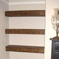 rustic floating shelf next to fireplace tv and