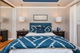 marvelous trans globe lighting in bedroom transitional with navy blue paint next to drum pendant alongside navy bedding and hanging lamp