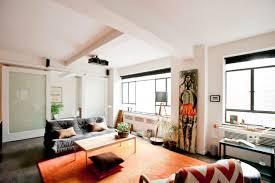modern built in firepit dark storage coffee table comfortable living room furniture low wooden table white floating rugs built furniture living room