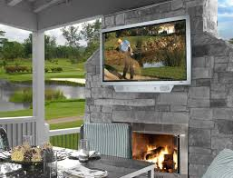 enticing outdoor patio ideas with stacked stone outdoor fireplace and wall mounted tv and white wooden gazebo