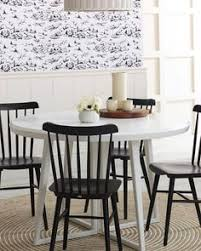 we love this dining room with a nautical wallpaper black chairs and natural rug