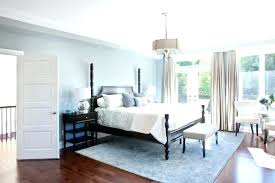 blue painted bedroom pale blue bedroom paint this bright and cheery bedroom demonstrates that dark furniture does not mean a dark space light blue painted