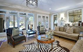 zebra rug living room elephant living room decor transitional with zebra rug walnut armchairs decorative pillows