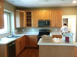 before kitchen cabinet painting honey oak cabinets with black granite countertops upgrade white paint on oak cabinets staining kitchen
