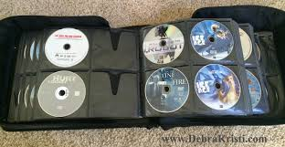 dvd storage case in 18 diy crafts upcycles for dvd cases by debra kristi