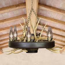 wagon wheel chandelier with deer antlers