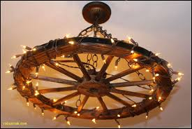 wagon wheel chandelier light fixture super easy i loved this project