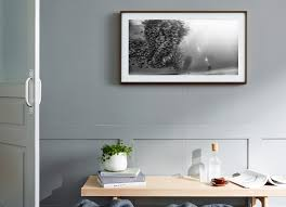 the frame is a wall mounted solution that doesn t look like a tv when it s not in use turn it off and the screen is replaced by what looks like a piece of