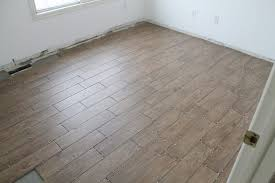 tips for achieving interior flooring using faux wood porcelain tile and realistic faux wood tile