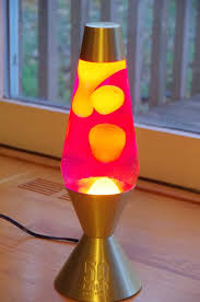 Retro Lava Lamp With Silver Base And Yellow Liquid Using
