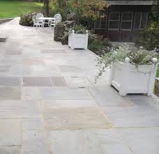 indian limestone paving slabs ireland. natural indian sandstone in grey has been used to transform the back garden of an old limestone paving slabs ireland