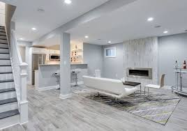 furniture for basement. Modern Basement Living Room With Small Kitchen Porcelain Tile Floor And White Furniture Fireplace For L