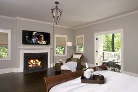 balboa mist paint traditional bedroom also balcony baseboards ceiling lighting crown molding dark floor fireplace mantel lanterns master bedroom media
