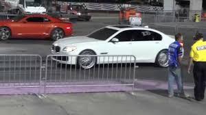 2011 Camaro SS vs 2010 BMW 750LI 1/4 Mile - YouTube