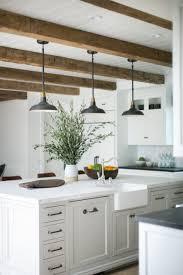 beams lighting. amazing rustic beams and pendant lights over a large kitchen island lighting e