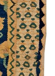 this circa antique runner rug features stylized fl abstractions in beige against a field flat weave