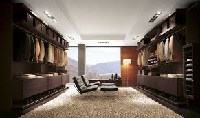 walk in closet dark wood cabinets mens clothing 2 rocking leather chair in middle standing lamp
