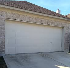 garage door repair service image showing the before pic a damaged wayne dalton garage