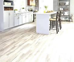 tile vs vinyl plank flooring wood mold under basement luxury porcelain or ceramic pictures sheet over