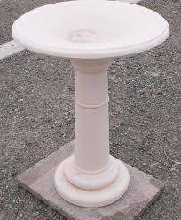 white concrete birdbath