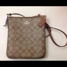 Coach signature Khaki  Saddle crossbody bag