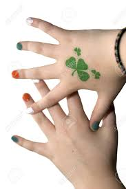 Young Girls Hands With A Shamrock Tattoo And Painted Finger Nails