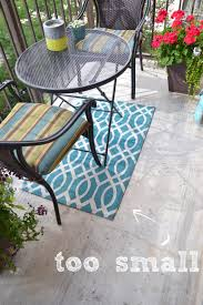 this outdoor rug is way too small for this space even though i love the