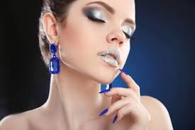 sparkle makeup closeup of beauty fashion with silver lipstick and glitter eyeshadow