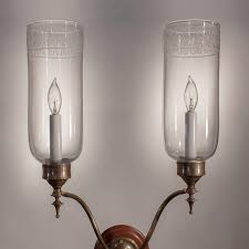 regency pair of double arm glass hurricane shade wall sconces for