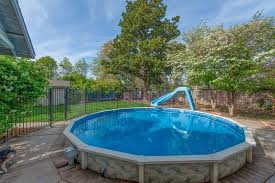 Image Inground Pool This Round Above Ground Pool Is Surrounded By Concrete Pool Area And Adorned With Pinterest 14 Great Aboveground Swimming Pool Ideas