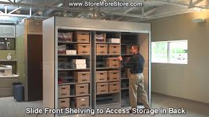 office storage cabinets. Large Office Storage Cabinet | Remote Controlled Doors With Sliding Shelving Units - YouTube Cabinets