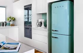 refrigerator vintage look. light blue retro fridge and white kitchen cabinets refrigerator vintage look d