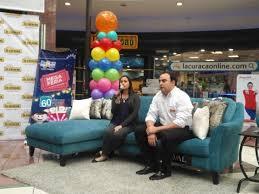 la mega furniture. representatives of la curacao invite to enjoy discounts with mega feria furniture