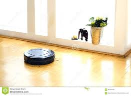 Robot Vacuum Cleaner In The Living Room Stock Photo